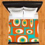 Mid century modern bedding cover in multicolor scheme bed frame with black leather headboard
