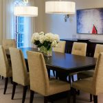 Modern Centerpieces For Dining Room Tables With Flowers Eight Armless Chair And Double Round Decorative Lights