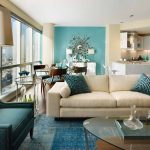 Modern Teal Living Room Decor On Wall Chair Floor And Pillows With Glass Round Table