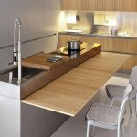 Modern-and-minimalist-looks-stainless-kitchen-island-but-have-versatile-features-that-hidden-wooden-plank-can-use-as-table-when-pull-out-perfect-combine-with-two-silver-kitchen