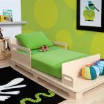 Modern minimalist wood bed frame idea with green mattress and green pillow  for toddler
