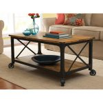 Modern rustic wood top coffee table with wrought iron legs and casters