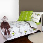 Modern toddler bed idea with comfy bedcover and pillows white round bedroom rug an animal stuff