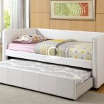 Modern trundle beds made of white leather with cute bedding set and greeneries for fresh appearance plus wooden wall and floor