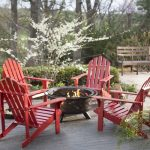 Outdoor fire pit idea for patio red painted wood chairs