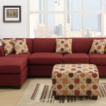 Red microfiber sectional with single chaise some accent pillows with polka dots pattern an ottoman table with polka dots pattern vertical storage system in black