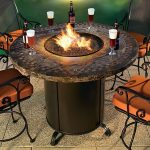 Round natural stone fire pit table with metal base