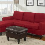 Simple red microfiber sectional with chaise black leather ottoman table white area rug with square motifs
