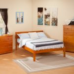 Simple solid wood bed frame with brown finishing two storage systems made of solid wood