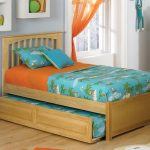 Simple wood trundle bed with bed addition