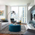 Small Apartment With Lounge Chairs For Living Room And White Sofa Complete With Fur Rug And Floor Lamp