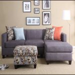 Smaller sectional unit with chaise and accent pillows and an ottoman table