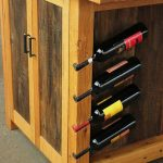 Solid wood kitchen island with wine bottle holders