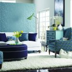 Teal Living Room Decor With Beautiful Wall Chair And White Fur Rug