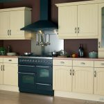 Traditional Kitchen Cabinet With Small Stove Oven On Purple Wall