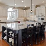 Triple Kitchen Pendant Light Fixture Above Marble Kicthen Island With Three Black Stools And White Cabinet Set