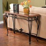 Warm Wooden Wrought Iron Sofa Table Behind White Sofa