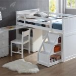 White bunk with desk stairs and storage small white shaggy bedroom rug