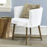 White club chair slipcover for reading chair which has unfinished wood legs tree trunk side table idea