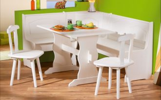 White corner bench kitchen design idea with white table and a couple of white chairs