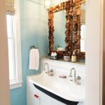 White kohler bathroom sink unit with two water faucets two units of vanity mirror with unique frames