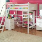 White painted wood bunk with stairs desk and bookcase units a white vanity with storage and white framed mirror white shag bedroom rug