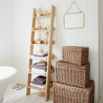 Wooden Ladder Shelving Unit In Bathroom With Box Storage