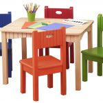 Wooden pink table and colorful chairs for kids