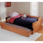 Wooden trundle with additional bed white rug for bedroom