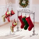 a-charming-wrought-iron-Christmas-stocking-holder-stand-with-white-and-black-color-also-5-hooks-in-the-vertical-stand-and-8-knobs-in-the-horizontal-stand