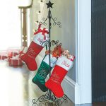 a-christmas-stocking-holder-stand-features-scrolled-detailing-and-the-horizontal-stocking-holder-includes-5-hooks for-holding-5-lbs-also-made-of-metal