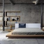 adorable bedroom design in the loft with gray tone and flat platform bed with gray sheet and unique shelves and lighting and concrete flooring