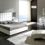 adorable bedroom design with uphostered headboard and white furry area rug and comfy chair for bedroom design in white tone