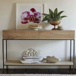adorable beige console table ikea design with black iron legs and potted plants and white painted wall