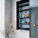 Adorable Black Bathroom Wall Shelves Design In Recessed Style In Bathroom With Concrete Rustic Siding And Indoor Plant Decoration