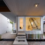 adorable front glass door with super large glass window and marble black flooring and concrete floating stairs and coral fields and deck ceiling