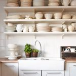 adorable kitchen shelving idea with creamy and dull white color and indoor plants with curved faucet and wooden top