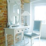 adorable vintage white vanity design with storagedrawers and blue chair