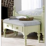 adorable white framed bed ottoman bench design with carved wooden legs and stripe bolster
