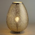 amazing coccon shaped unusual table lamp design with sparkling decoration on wooden table