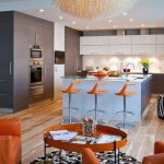 amazing kitchen design interior with blue island and orange stools and orange sofa with unique coffee table and black white patterned area rug and wooden floor