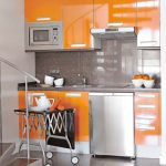 amazing orange kitchen design with cool cabinetry and portable breakfast nook and gray accent and modern flooring