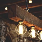 amazing rustic wooden light fixture design with light bulb track design beneath the ceiling
