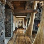 amazing wooden house interior hallway idea with log decoration and stone wall idea and wooden floor and ceiling