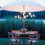 amusing lighted patio umbrella with candle light lantern featuring round table and four chairs