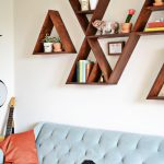 Artistic Wooden Diy Wall Shelves Idea In Letter Shape Above Soft Blue Tufted Sofa With Sectional And Coral Colored Cushions