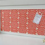 awesome and decorative magnetic board in white and red patterned fabric as the background for home accessories ideas