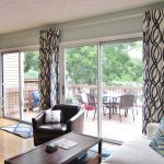 Awesome Extra Long Curtain Rods For Sliding Glass Door With Wooden Laminate Floor And Wooden Coffee Table Plus Awesome Comfy Loveseat
