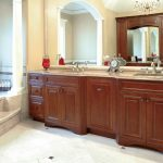 awesome image of wooden bathroom cabinet and images of bathroom vanities plus granite countertop plus stunning mirror and chrome finish faucet adorned with chrystal ceiling light