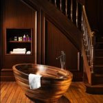awesome interior design of bathroom understairs with wooden floor and wooden bathtub and modern faucet and wall recessed cabinet